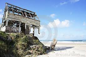 Lovely beach home for sale needs a little TLC.